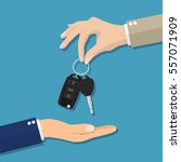 car seller hand giving key to... | Shutterstock .eps vector #557071909