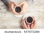 hot coffee in the hands of a... | Shutterstock . vector #557072284