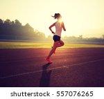young fitness woman runner... | Shutterstock . vector #557076265