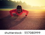Young Fitness Woman Runner Pus...