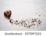 heart shaped chocolate on white ... | Shutterstock . vector #557097331