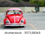Blurred Red Car Parking At A...