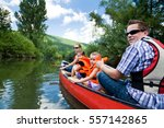 young family canoeing | Shutterstock . vector #557142865