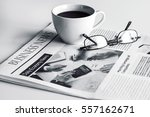 Newspaper With Eyeglasses On...