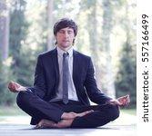 businessman in suit practicing... | Shutterstock . vector #557166499