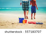 father and son go swim at beach | Shutterstock . vector #557183707
