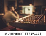 Small photo of Sound engineer working at mixing panel in the boutique recording studio