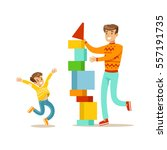 dad and son building a tower... | Shutterstock .eps vector #557191735