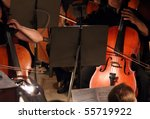 close-up view on two violoncello in orchestra - stock photo