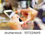 people using a smart phone... | Shutterstock . vector #557224645
