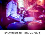 Drummer Playing On Drum Set On...