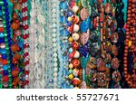 Lot of colored beads from different minerals at the showcase - stock photo