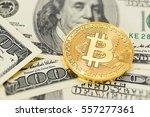 golden bitcoin on us dollar... | Shutterstock . vector #557277361