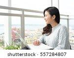 woman who enjoy the laptop... | Shutterstock . vector #557284807