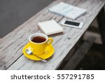 a cup of lemon tea and notepad  ... | Shutterstock . vector #557291785