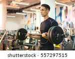 young strong man working out... | Shutterstock . vector #557297515