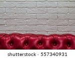 red leather sofa in a white...