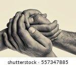 men's hands hold the female... | Shutterstock . vector #557347885