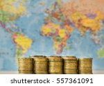 metal coins on a background map ... | Shutterstock . vector #557361091