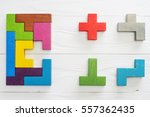 Small photo of IQ test. Choose correct answer. Logical tasks composed of colorful wooden shapes, top view. Children's educational logical task, flat lay. Visual conundrum, find the missing piece of the proposed.