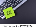 sticky note on keyboard with... | Shutterstock . vector #557371174