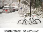bike covered with fresh snow in ... | Shutterstock . vector #557393869