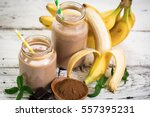 banana and chocolate smoothie... | Shutterstock . vector #557395231
