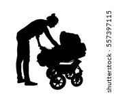 young mother rolls the baby in... | Shutterstock .eps vector #557397115