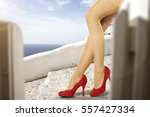 woman legs and heels  | Shutterstock . vector #557427334