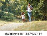 mother and daughter playing and ... | Shutterstock . vector #557431459