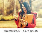 young woman in the park using... | Shutterstock . vector #557442355