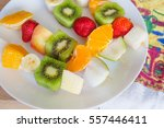 fruit skewers on the plate the... | Shutterstock . vector #557446411