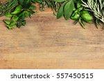 herbs on wooden background | Shutterstock . vector #557450515