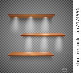 vector empty wooden shelves... | Shutterstock .eps vector #557474995