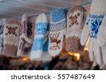 a variety of woolen mittens... | Shutterstock . vector #557487649