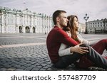 young couple sitting together... | Shutterstock . vector #557487709