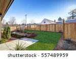 Sloped backyard surrounded by...
