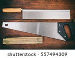 hand saws and wooden meter on... | Shutterstock . vector #557494309