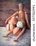 wooden man model holding easter ... | Shutterstock . vector #557502991