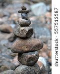piled smooth rocks | Shutterstock . vector #557513587
