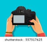 Photograph's Hands Holding Dsl...