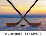 Crossed Ice Hockey Sticks With...