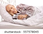 senior sleeping in bed isolated ... | Shutterstock . vector #557578045