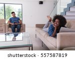 young multiethnic couple... | Shutterstock . vector #557587819