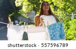 young woman hangs laundry of... | Shutterstock . vector #557596789