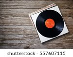 a stack of vinyl records on a... | Shutterstock . vector #557607115