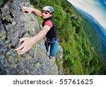 Young White Man Climbing A...