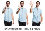 handsome man counting one ... | Shutterstock . vector #557617801