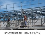 worker work with iron frame... | Shutterstock . vector #557644747