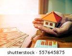 businessman holding paper home... | Shutterstock . vector #557645875